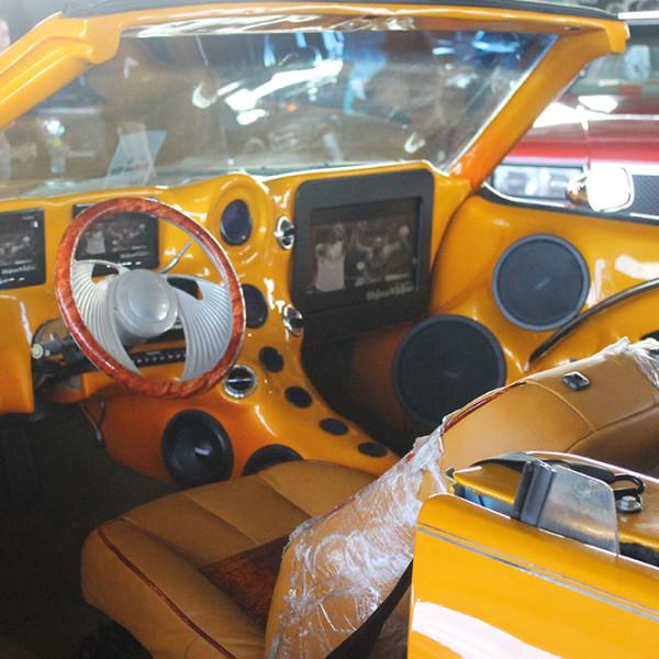 Riding-Big-Car-Show-Orange-Car
